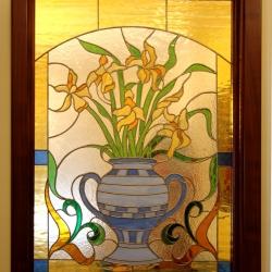 Vetrata con orchidee in vaso